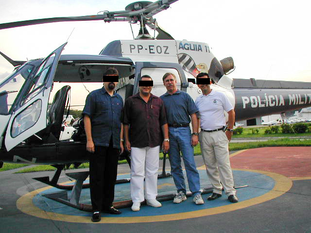 Dave – second from right – with a Eurocopter AS350 Écureuil (Squirrel) flown by the Policia Militar de Sao Paulo. Click to enlarge.